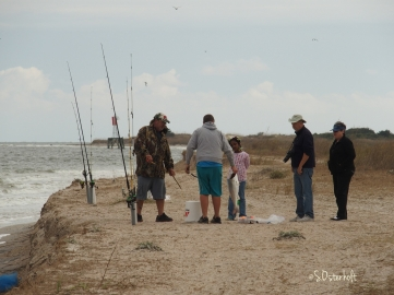 Teenager shows off his Redfish to a visiting family.