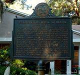 Marker outside of visitor center explains park history.